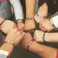 group of people with awareness wristbands
