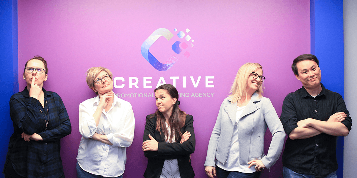 Creative team against a logo wall
