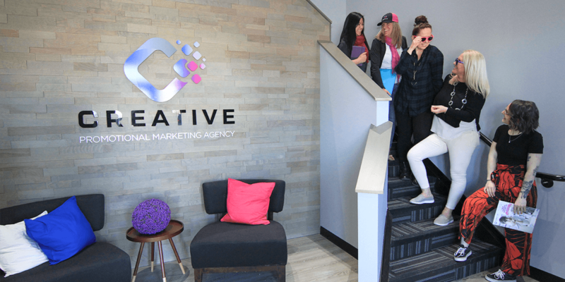 Creative Promotional Marketing foyer with our team on the staircase