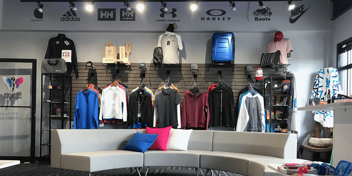 Creative Boutique wall of promotional apparel and various promotional products