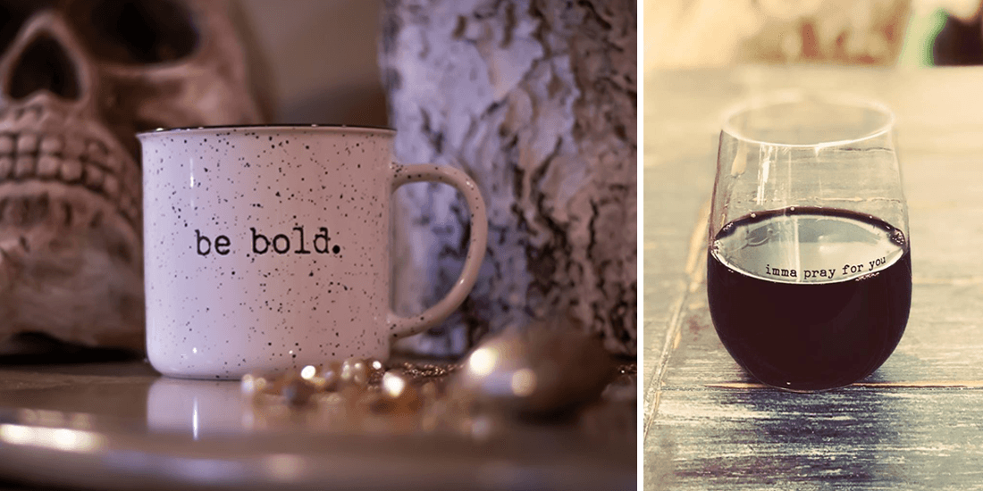 Speckled mug and a stemless wine glass imprinted with quotes for an online store
