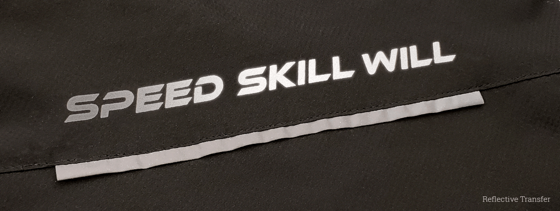 detail showing a reflective transfer method on the logoed tracksuit