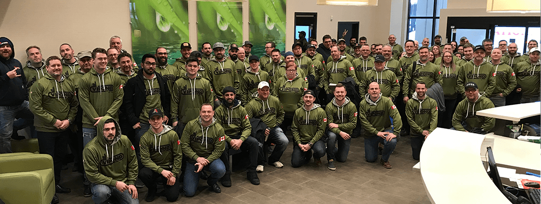 The entire Vipond team wearing their branded hoodies
