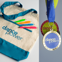 competition medals and event merchandise and giveaways for a dancing event