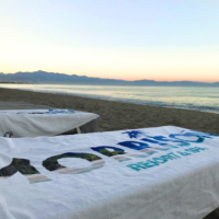 personalized, full color towels on a tropical beach