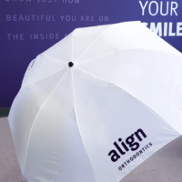 white umbrella imprinted with the client's logo