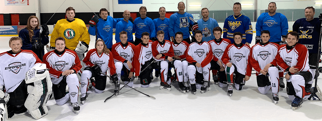 team and coaches of Enforcers, wearing their custom jerseys and socks