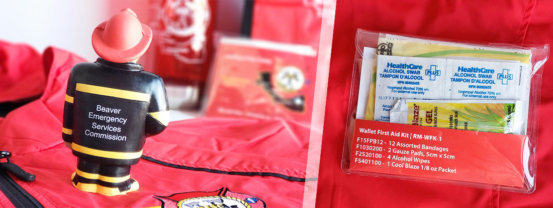 close up view of branded stress reliever fireman and logoed first aid kits