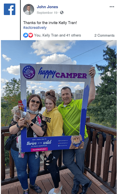 Clients with selfie frames at Camp CREATIVE posting on Facebook