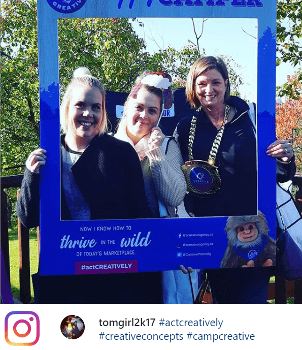 three happy clients posing in a selfie frame at Camp CREATIVE, our recent open house