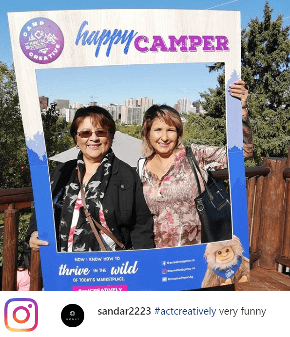 two clients in a happy camper selfie frame at our recent open house