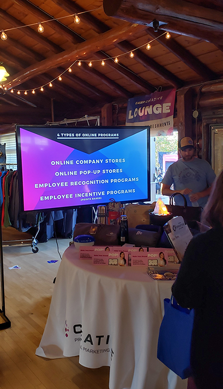 Programs booth at the open house displaying incentive programs and online company stores we provide