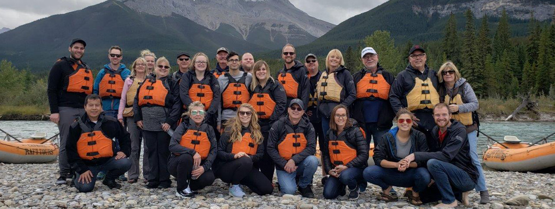 company team wearing their branded jackets at a corporate retreat