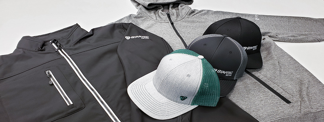 branded apparel and headwear, embroidered with Startec logo