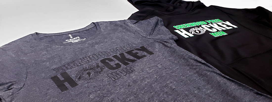 close-up of the imprints on the heather t-shirt and black hoodie with association logo