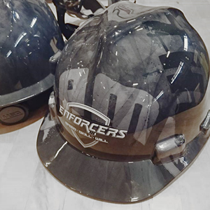 Player of the Game Helmets project with custom hard hats for a hockey team