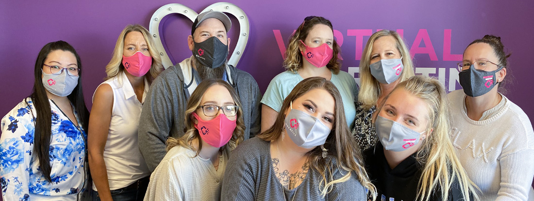 CREATIVE team wearing the logoed masks